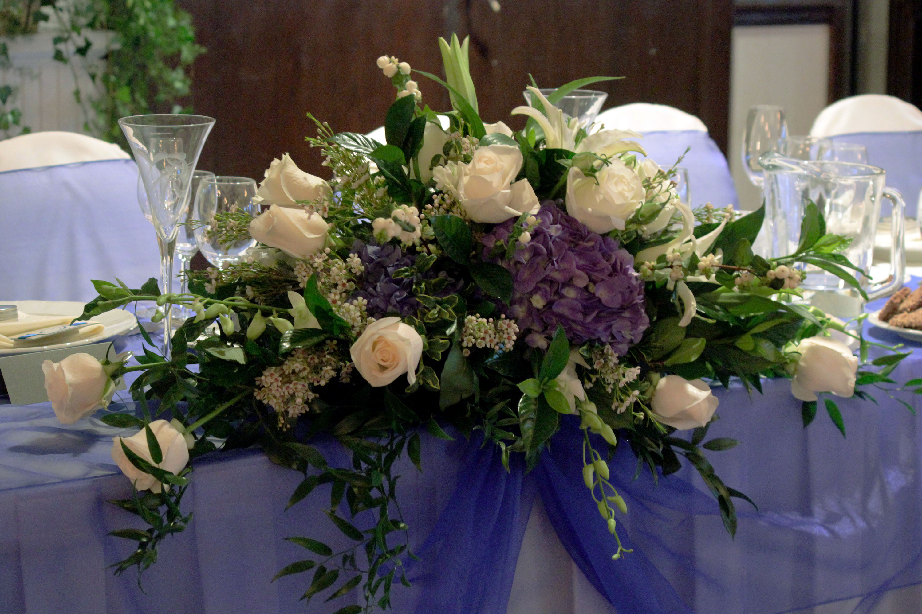 Deep blue wedding bridal party table centerpiece