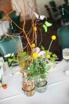 Garden Wedding Centerpieces; Jars filled with Bupleurum, Billy Balls, Verigated Pit and Curly Willow with buttlerflies and gems.